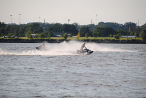 Jet skis enjoying the ship wake